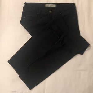 black skinny knee ripped jeans